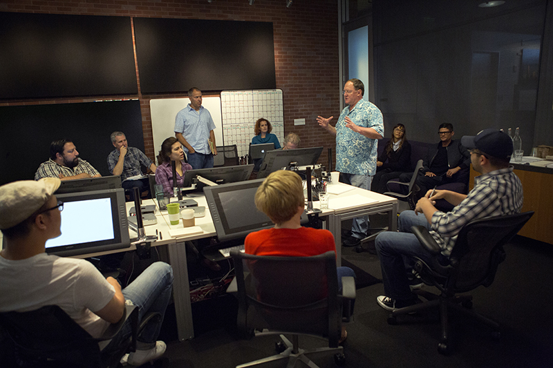 """Director John Lasseter works with members of his story team on Disney•Pixar's """"Toy Story 4,"""" a new chapter in the lives of Woody, Buzz Lightyear and the """"Toy Story"""" gang. The film is slated for release in 2017. (Photo by Deborah Coleman / Pixar) Photo by: Deborah Coleman / Pixar. ©2014 Disney•Pixar. All Rights Reserved."""