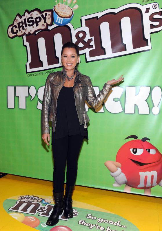 (December 9, 2014) Vanessa Williams, the multi-talented entertainer and voice behind M&M'S(R) Brand spokescandy Ms. Brown, welcomes the first batch of M&M'S(R) Crispy to M&M'S World(R) in Times Square. The product will begin returning to store shelves nationwide this week after a 10-year hiatus, thanks to a vocal fan base who pleaded for its return. (Photo by Diane Bondareff for Mars Chocolate North America) (PRNewsFoto/Mars Chocolate North America)