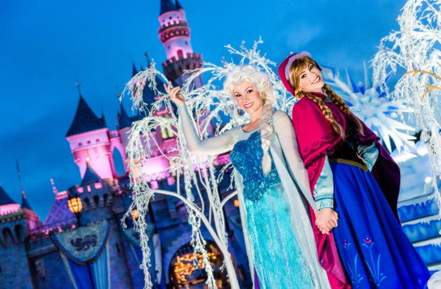 """Frozen"" Sisters Join ""A Christmas Fantasy"" Parade for 2014 Holidays - Anna and Elsa, sisters from the Disney animated hit ""Frozen,"" will join the cast of ""A Christmas Fantasy"" parade this year for the annual holiday celebration at the Disneyland Resort, Nov. 13 through Jan. 6, 2015. The popular visitors from Arendelle will greet guests from a magical parade float of snow and ice, created by Queen Elsa. In this photo, Anna and Elsa appear as they have been seen in the ""Frozen"" pre-parade at Disneyland Park, prior to the Holidays. (Disneyland Resort)"