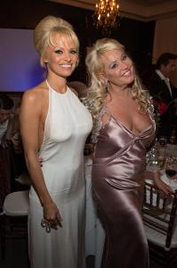 Pamela Anderson was awarded the humanitarian award for her animal activism at the Fifth Annual Better World Awards (here) celebrating with Executive Producer of the BWA , Ms. Gina deFranco at the Hotel Ella on Oct. 31, 2014. The BWA held in Austin, Texas as the Official Opener for F1. Kelly Wright of Fox news emceed and will feature the BWA on Fox's Beyond the Dream which he hosts, Saturday, Nov. 8,2014. Valerie Valesquez co-produced with International Luxury Media & Gina deFranco. Guests: Nichole Galisia (Django), Alysa Reiner, David Basche, CJ Eiricksson, Tyler Barrett, Kyle Huangs, Mark Dickens, (f1 painter)Sponsors: DB, Amicus Global Vision, MRGTX. (PRNewsFoto/International Luxury Media Inc.)