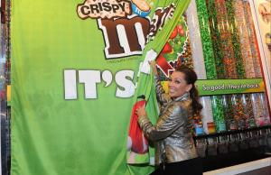 (December 9, 2014) Vanessa Williams, the multi-talented entertainer and voice behind M&M'S(R) Brand spokescandy Ms. Brown, unveils the first tubes of M&M'S(R) Crispy on the famous M&M'S World(R) Candy Wall featured at the store in Times Square. (Photo by Diane Bondareff for Mars Chocolate North America) (PRNewsFoto/Mars Chocolate North America)