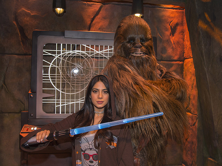 "(January 27, 2016) – Actress Emeraude Toubia, from the Freeform series ""Shadowhunters,"" poses with Chewbecca at Star Wars Launch Bay at Disneyland Park in Anaheim, Calif. on Wednesday, Jan. 27, 2016. (Paul Hiffmeyer/Disneyland)"